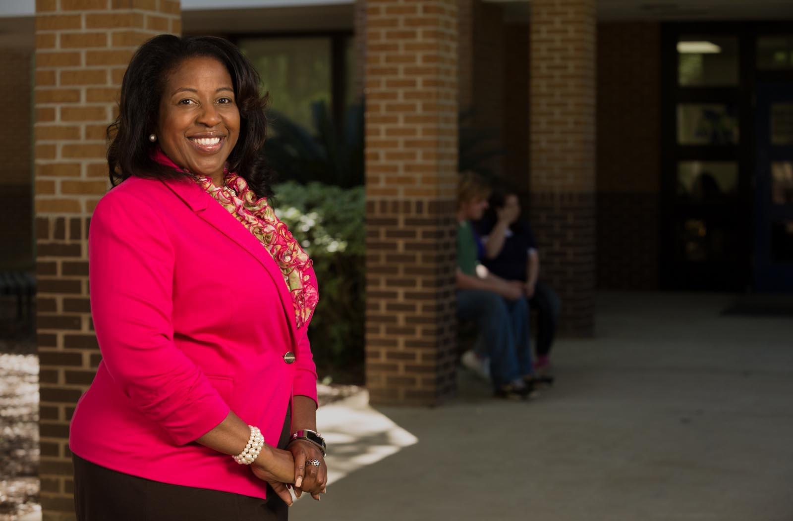 Regina Browning in front of school