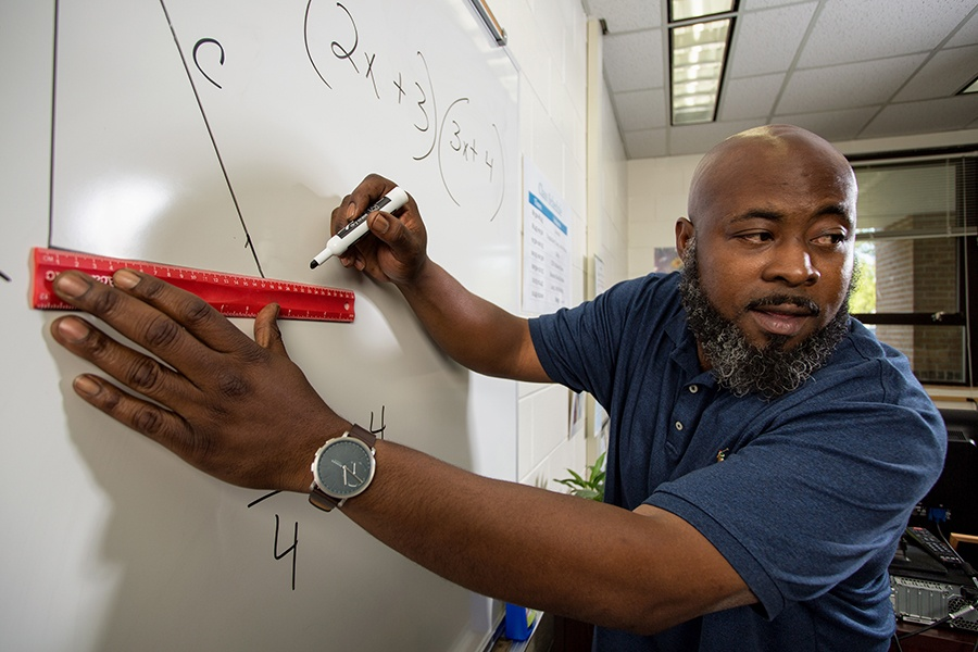 ACE GED Teacher Charles Williams teaches math