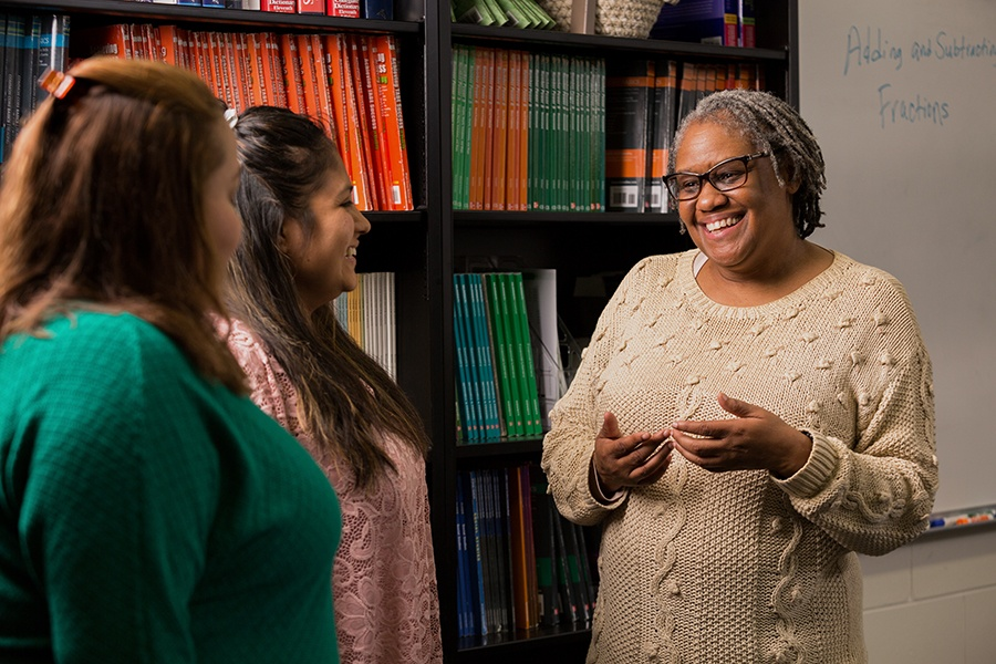 ACE Teacher Stephanie Young talks with students